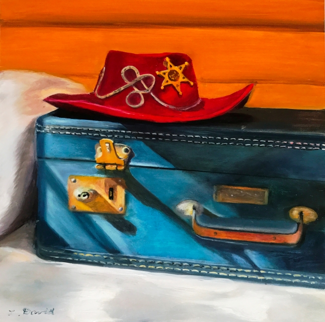 Blue suitcase with red hat